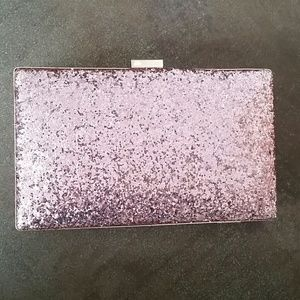 Sparkly pink clutch with arm strap